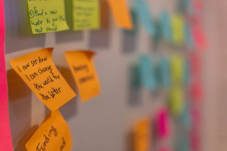Sticky notes on a wall.