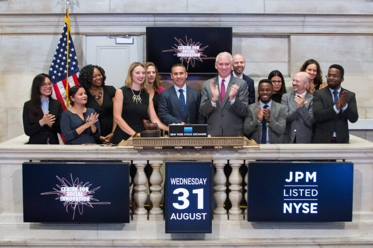 CSI New York staff ring the opening bell at the New York Stock Exchange