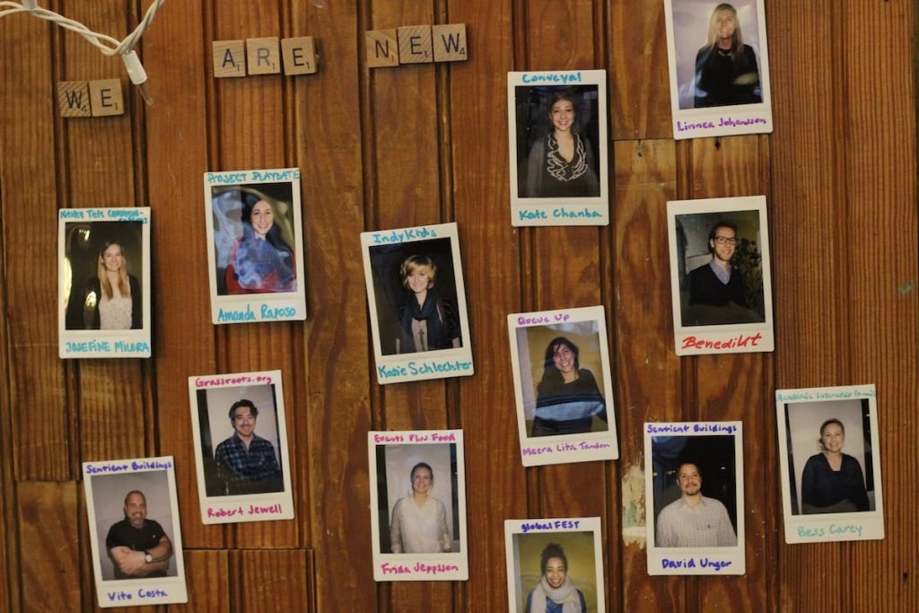 Polaroids of new CSI New York members on a wooden wall