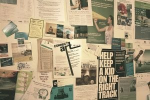 A bulletin board full of posters