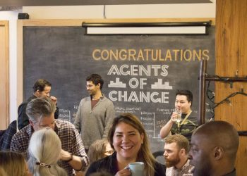 People networking at the Agents of Change City Builders Grad Event