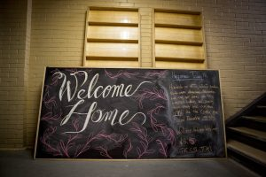 Chalkboard welcoming CSI members home as they move into 192 Spadina. Photo credit: Sara Elisabeth Photography.