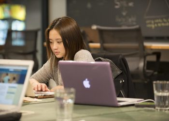 Young woman using her laptop at CSI New York